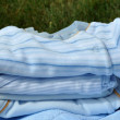 Pile of Blue Baby Clothes — Stock Photo