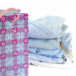 Gift Bag and Blue Baby Clothes — Stock Photo