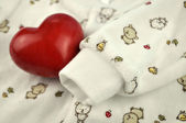 Red Heart on Baby Sweater — Stock Photo
