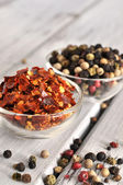 Peppercorn and Crushed Chilli Pepper — Stock Photo