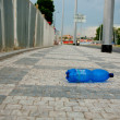 PET bottle on sidewalk — Stockfoto