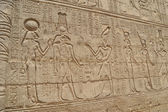Hieroglyphic carvings in an Egyptian temple wall — Stock Photo