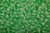 Green handmade art paper floral ethnic pattern — Stock Photo