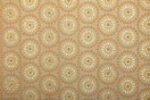 Beige handmade art paper with floral traditional print — Stock Photo