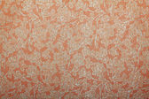 Orange glittered handmade art paper with floral pattern — Stock Photo