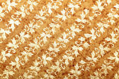 Brown handmade art paper with diagonal floral pattern — Stock Photo
