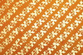 Orange handmade art paper with diagonal floral pattern — Stock Photo