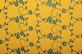Yellow handmade art paper with blue floral pattern — Stock Photo