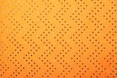 Orange handmade art paper with dotted zigzag pattern — Stock Photo