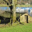 Old boatshed beside Coniston Water - Stock Photo