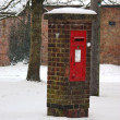 Wintry post box covered in snow — Stock Photo