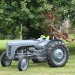 Vintage tractor with acrobat — Stock Photo #6399460