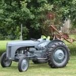 Vintage tractor with acrobat — Stock Photo