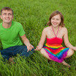 Stock Photo: Couple on grass and meditate together smiling