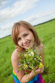 Girl with a bouquet of wild flowers — Stock Photo