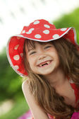 Girl with toothless smile — Stock Photo