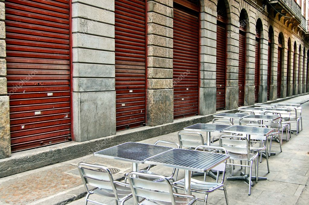 Bar tables and chairs in narrow street — Stock Photo #6487822