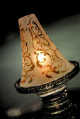 Close up of a lighted ancient lamp — Stock Photo