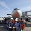 Stock Photo: Airplane mechanics and airliner
