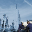 Workers and refinery — Stock Photo