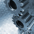 Engineering gears in blue - Stock Photo