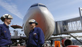 Airliner and mechanics — Stock Photo