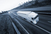Truck in speedy motion — Stock Photo