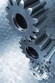 Engineering gears in blue — Stock Photo