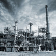 Oil refinery with dark storm clouds — Stock Photo