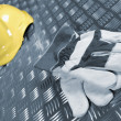 Workers gloves and hardhat — Stock Photo