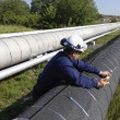 Engineer and giant pipeline — Stock Photo