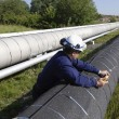 Stock Photo: Engineer and giant pipeline