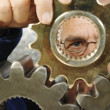 Phycisist examining gears - Foto de Stock  