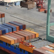 Cargo containers, ship and crane - Foto Stock
