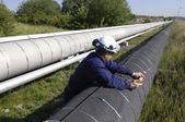 Ingegnere e gigante della pipeline — Foto Stock