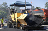 Asphalt paving and worker — Stock Photo