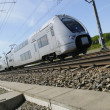 High speed train zooming past - Stockfoto