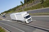 Giant truck on scenic highway — Foto de Stock