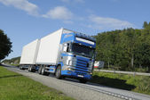 Trucking on country highway — Stock Photo