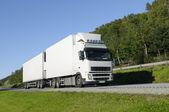 Giant truck on scenic highway — Stock Photo