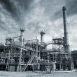 Refinery, industrial clouds and fog - Stock Photo