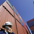 Port worker and cargo containers — Stock Photo #6503220