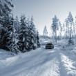 Suv, car on snowy roads — Stock Photo