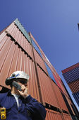 Port worker and cargo containers — Stock Photo