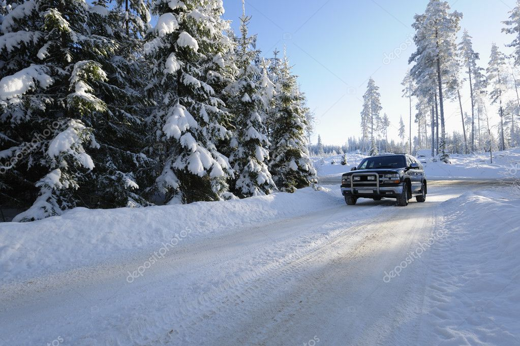 Large suv, car, driving on snowy road in a swedish winter landscape — Stock Photo #6506963