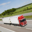Trucking on highway - Stock Photo