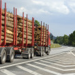 Timber truck on the move - Stock Photo