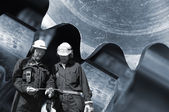 Steel workers and machinery — Stock Photo