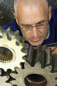 Engineer and machine parts — Stock Photo