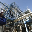 Engineer and oil refinery — Stock Photo